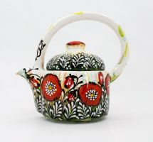 Ceramic teapot painted with poppies