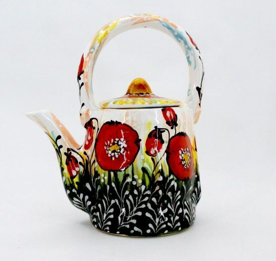 Traditional ceramic teapot painted with poppies