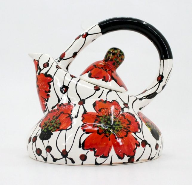 Extravagant ceramic teapot with poppies