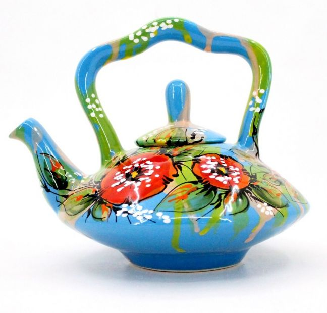 Blue ceramic teapot painted with poppies