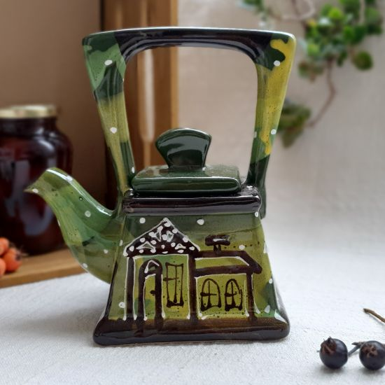 Small pottery teapot with house motifs, hand painted