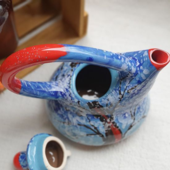 Painted ceramic teapot with winter nature