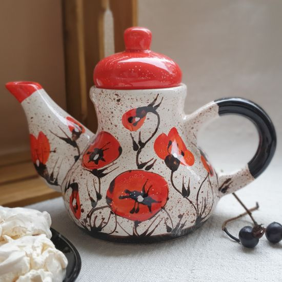 Design clay teapot with poppies