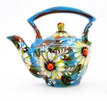 Blaue keramik Teekanne mit Gänseblümchen