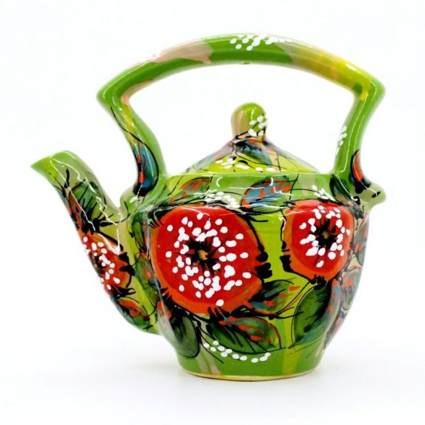 Green ceramic teapot with poppies