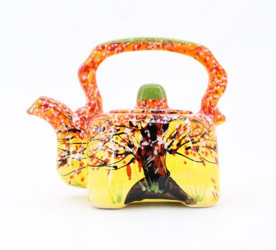 Original ceramic teapot with autumn motifs