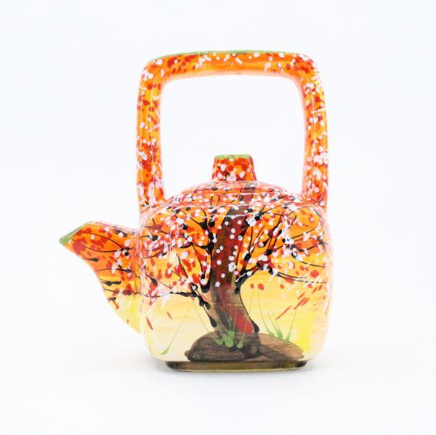 Design clay teapot with autumn motifs