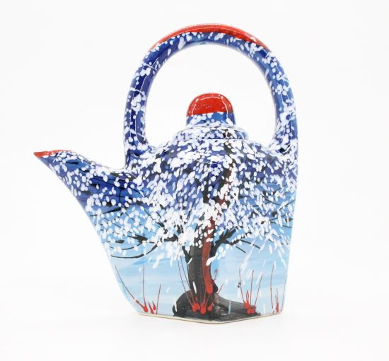 Pottery teapot with winter motifs