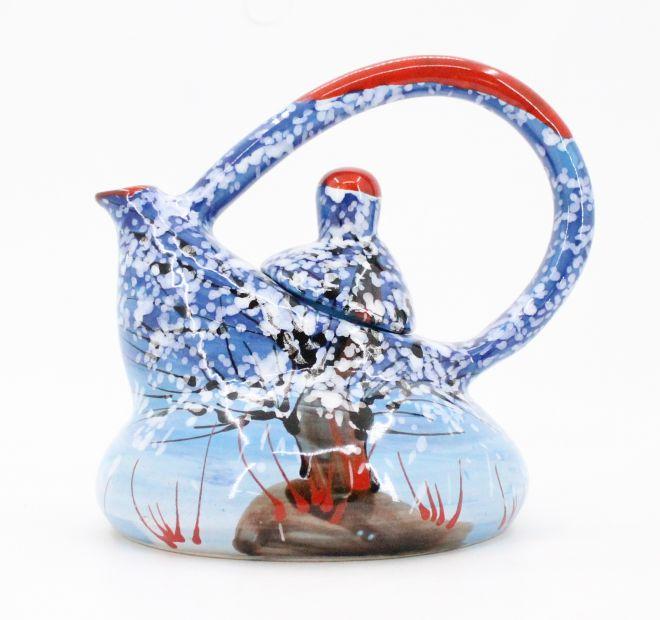 Original ceramic teapot with winter motifs