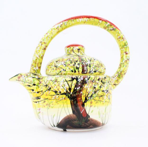 Bunte keramik Teekanne mit Frühlingsmotive