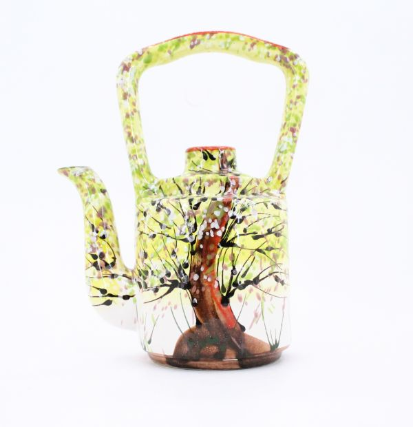 Pottery teapot with spring motifs