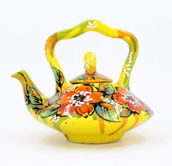 Yellow pottery teapot with poppies
