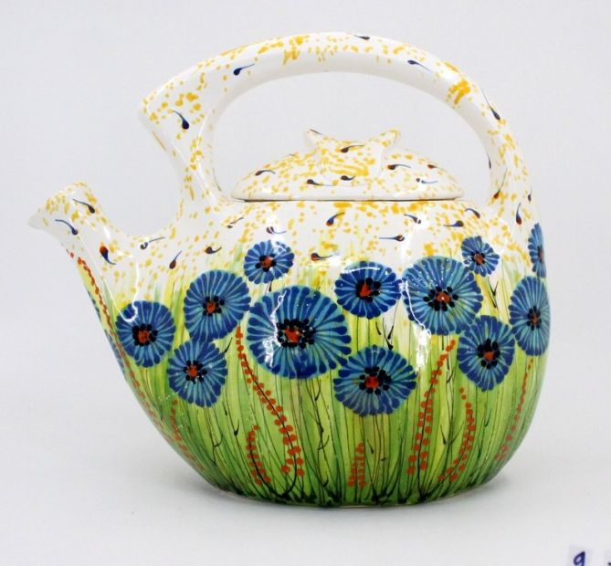 Colorful ceramic teapot with blue flowers