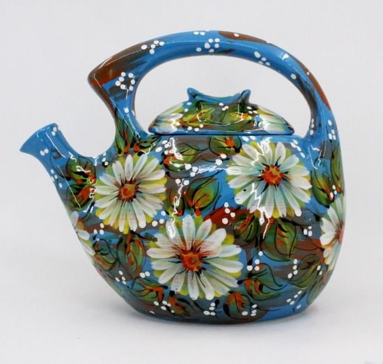 Hand-painted pottery teapot with white flowers