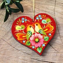Red Christmas ornaments in heart shape with Petrykivka painting