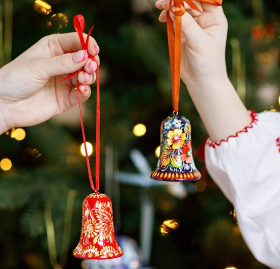 Christmas bell made of wood, red and gold
