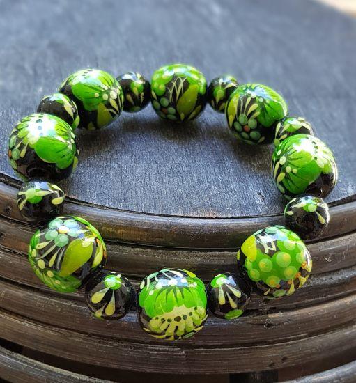 Wooden beaded bracelet with green flowers, handmade folk wooden jewelry