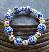 Wooden beaded bracelet with blue flowers, handmade folk wooden jewelry