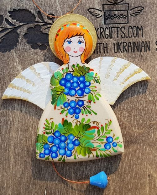 Angel decoration with moving wings, made of wood and hand painted