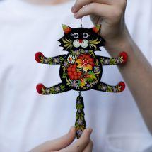 Schwarze Katze -  witziger Hampelmann aus Holz - Wanddeko für Kinderzimmer