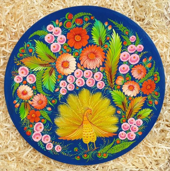 Decorative wooden plate Peacock, traditional ukrainian art