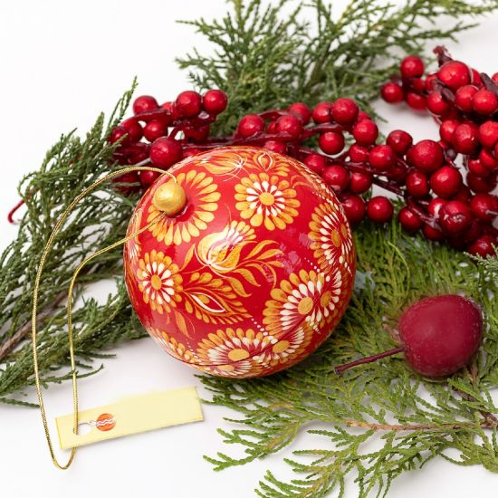 Hand-painted red and gold wooden Christmasball to open