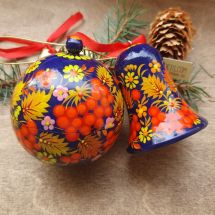 Delicate painted Christmas ball and wooden Christmas bell, Ukrainian handicraft