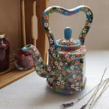 Hand painted pottery teapot with small flowers
