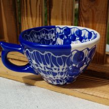 Handmade blue ceramic cup with abstract ornaments