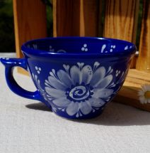 Hand painted blue ceramic cup with white flowers