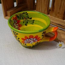 Hand painted ceramic cup with flowers