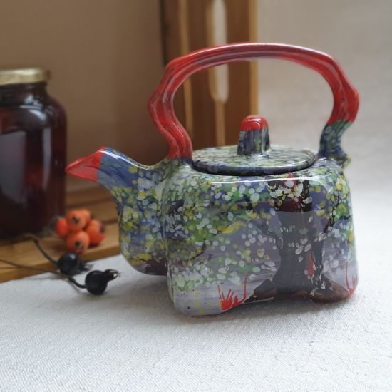Colorful ceramic teapot with spring motifs