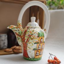 Design clay teapot with houses