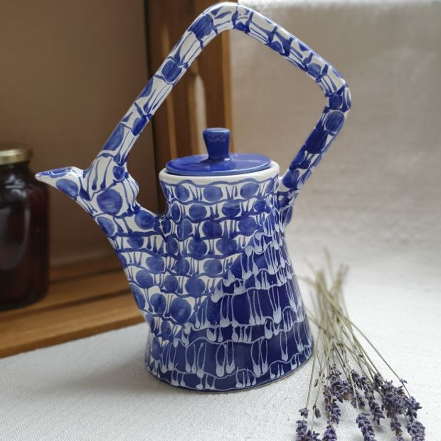 Design clay teapot with blue pattern