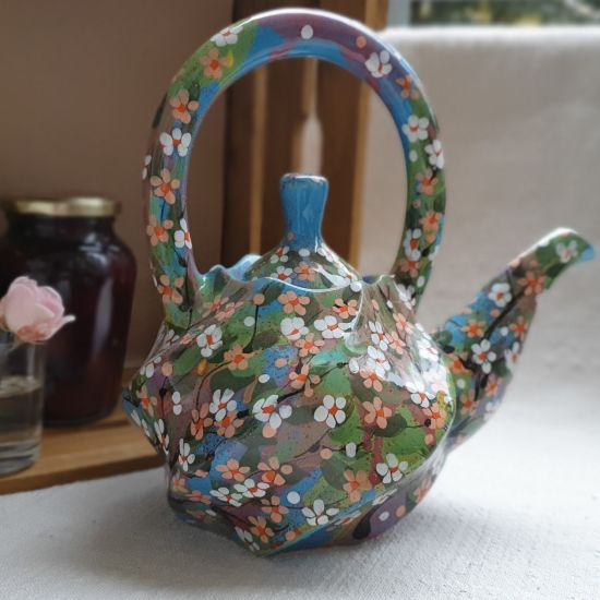 Ceramic teapot hand painted with small flowers