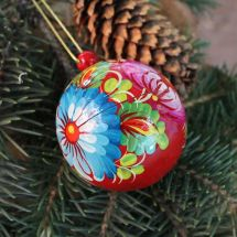 Traditional painted red Christmas ball, Petrykivka painting