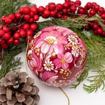 Artfull designed wooden Christmas ball with flowers motif