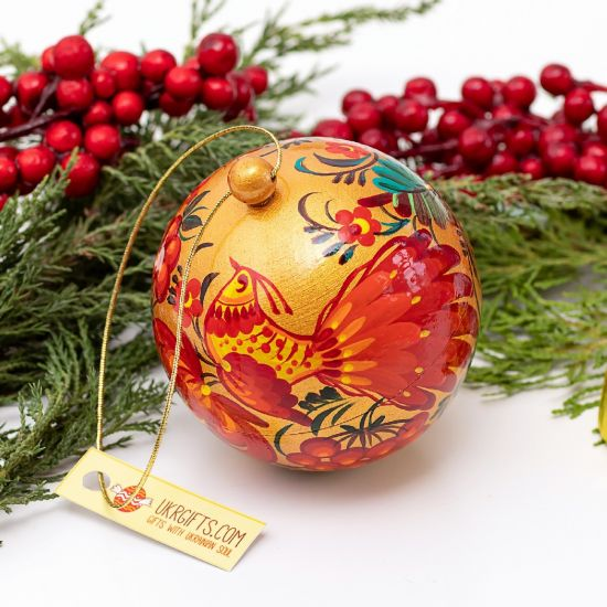 Gold-red Christmas ball artisticall hand painted with a bird motif
