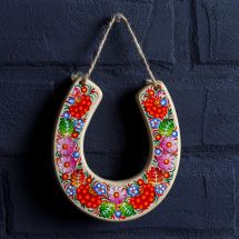 Lucky charm horseshoe to hang above the door, traditional painting