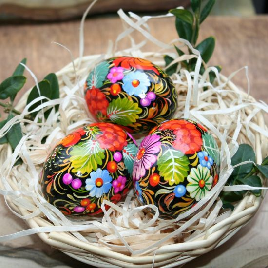 Traditional Ukrainian Easter eggs with Petrykivka painting in a basket - Easter decoration