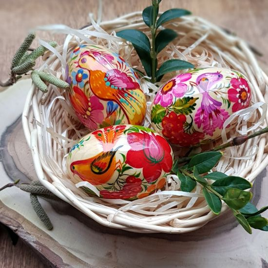 Easter decoration - hand painted wooden Easter eggs in a basket
