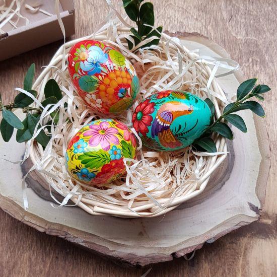 Hand painted wooden Easter eggs in a basket - Ukrainian handicraft