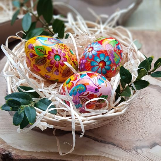 Creative Easter eggs Ukrainian painted in a basket - wooden Easter decorations
