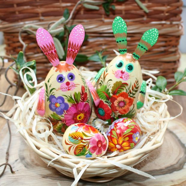 Funny Easter rabbits with 3 small Easter eggs in the basket