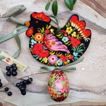 Creative hand painted Easter chicken with an egg -  wooden Easter folk ornaments, black