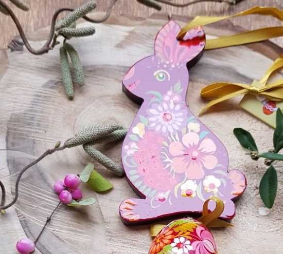 Creative Easter rabbit with an egg -  wooden Easter folk ornaments, red