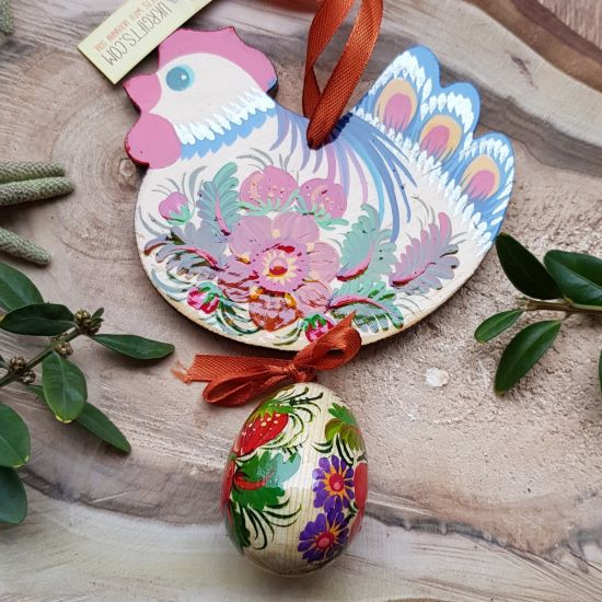 Pretty handmade Easter chicken with an egg -  wooden traditionel Easter ornaments