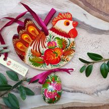 Rustic handmade Easter chicken with an egg -  wooden traditionel Easter ornaments