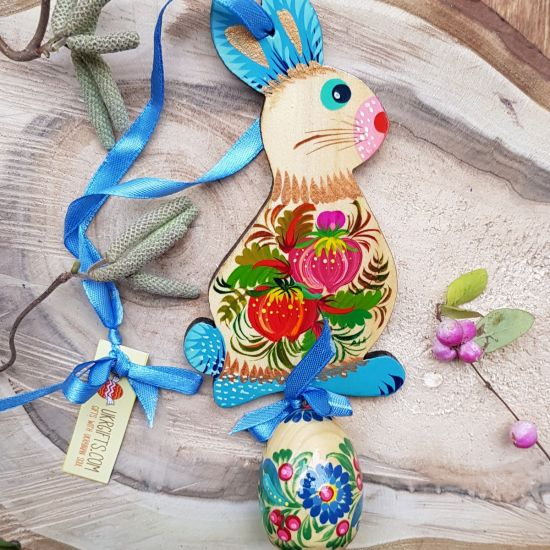 Easter bunny with an egg - hand painted wooden Easter decoration, blue