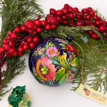 Christmas ball delicate hand painted with the bird as a motif
